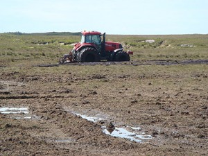 A turf contractor extracting peat from the Roundstone Bog, Special Area of Conservation in Co. Galway