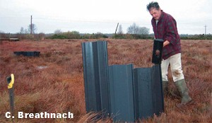 Blocking a drain on Lodge Bog, Co. KIldare with Plastic Lumbar