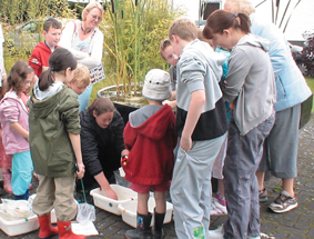 Visitors experience pond dipping at the IPCC's Bog of Allen Nature Centre, Kildare, Ireland
